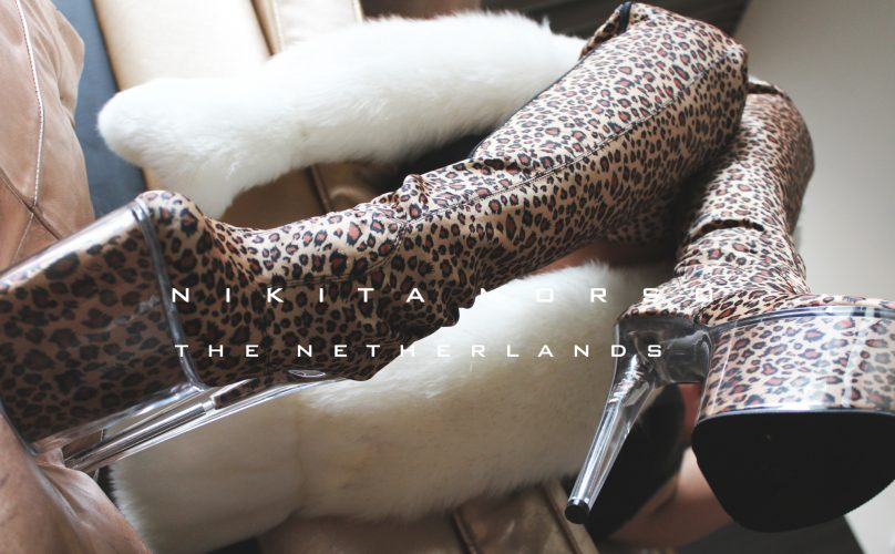 leopard boots sitting 2000x1200 NETHERLANDS 500x500 - Gallery